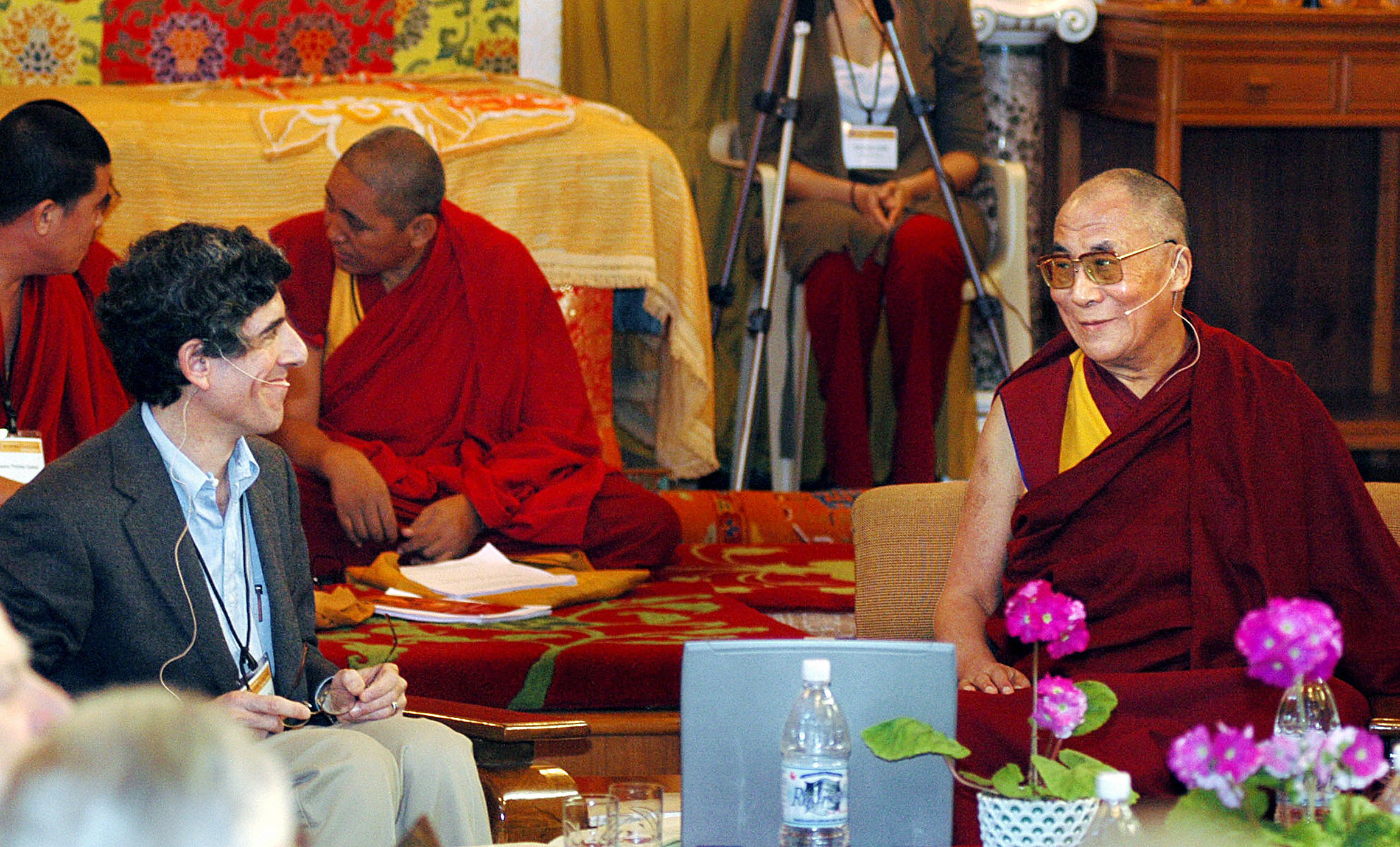 The Dalai Lama (R) smiles at Dr. Richard